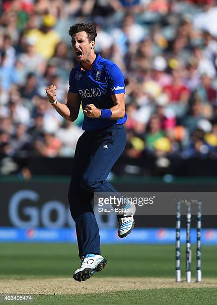 Steven Finn of England celebrates after taking the wicket of George Bailey of Australia during the 2015 ICC Cricket World Cup match between England...
