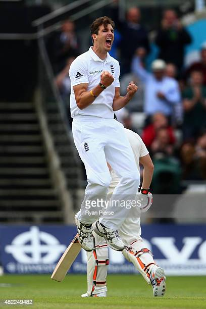 Steven Finn of England celebrates after taking the wicket of Steve Smith of Australia during day one of the 3rd Investec Ashes Test match between...