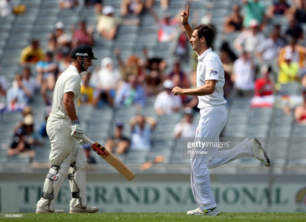 Steven Finn of England celebrates his wicket of <a gi-track='captionPersonalityLinkClicked' href=/galleries/search?phrase=Hamish+Rutherford&family=editorial&specificpeople=4880824 ng-click='$event.stopPropagation()'>Hamish Rutherford</a> of New Zealand (L) during day one of the Third Test match between New Zealand and England at Eden Park on March 22, 2013 in Auckland, New Zealand.