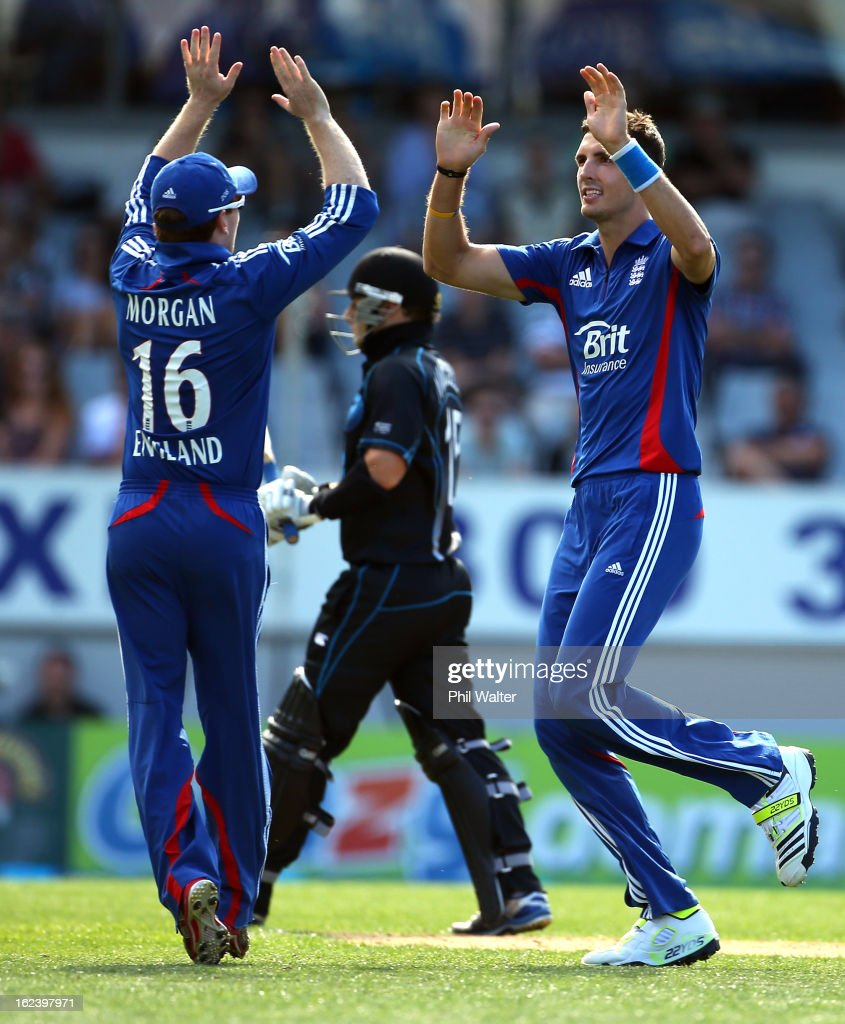 Steven Finn of England (R) celebrates his wicket of <a gi-track='captionPersonalityLinkClicked' href=/galleries/search?phrase=Nathan+McCullum&family=editorial&specificpeople=884481 ng-click='$event.stopPropagation()'>Nathan McCullum</a> of New Zealand (C) with <a gi-track='captionPersonalityLinkClicked' href=/galleries/search?phrase=Eoin+Morgan&family=editorial&specificpeople=689581 ng-click='$event.stopPropagation()'>Eoin Morgan</a> (L) during the third game in the International One Day series between New Zealand and England at Eden Park on February 23, 2013 in Auckland, New Zealand.
