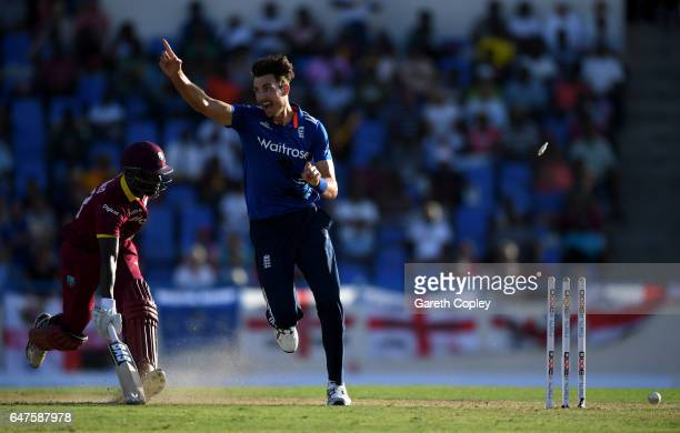 Steven Finn of England celebrates running out Jason Mohammed of the West Indies during the first One Day International between the West Indies and...