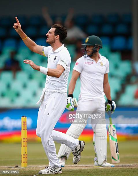 Steven Finn of England celebrates taking the wicket of Faf du Plessis of South Africa during day four of the 1st Test between South Africa and...