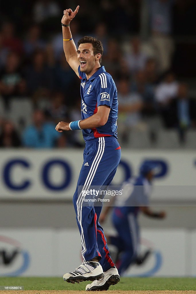 Steven Finn of England celebrates the wicket of Ross Taylor of New Zealand during the 1st T20 International between New Zealand and England at Eden Park on February 9, 2013 in Auckland, New Zealand.