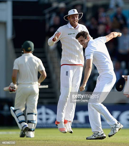 Steven Finn of England celebrates with Stuart Broad after dismissing Mitchell Johnson of Australia during day two of the 3rd Investec Ashes Test...