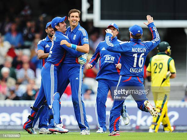 Steven Finn of England celebrates with team mates Ravi Bopara Craig Kieswetter Graeme Swann and Eoin Morgan after running out David Hussey of...