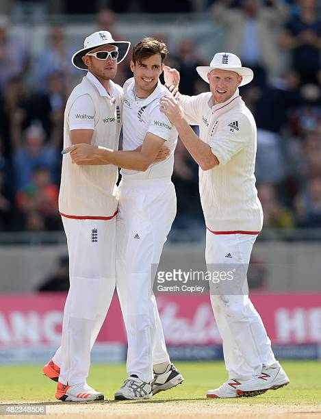 Steven Finn of England celebrates with teammates Stuart Broad and Ben Stokes after dismissing Steven Smith of Australia during day two of the 3rd...