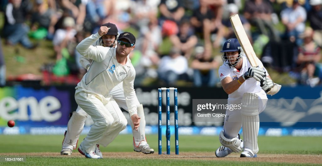 Steven Finn of England hits past New Zealand captain <a gi-track='captionPersonalityLinkClicked' href=/galleries/search?phrase=Brendon+McCullum&family=editorial&specificpeople=208154 ng-click='$event.stopPropagation()'>Brendon McCullum</a> during day five of the First Test match between New Zealand and England at University Oval on March 10, 2013 in Dunedin, New Zealand.