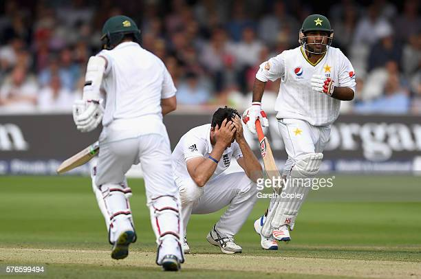 Steven Finn of England reacts as Yasir Shah and Sarfraz Ahmed of Pakistan score runs during day three of the 1st Investec Test between England and...