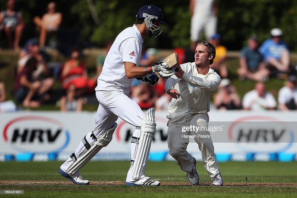 Steven Finn of England runs into Kane Williamson of New Zealand during day five of the First Test match between New Zealand and England at University Oval on March 10, 2013 in Dunedin, New Zealand.