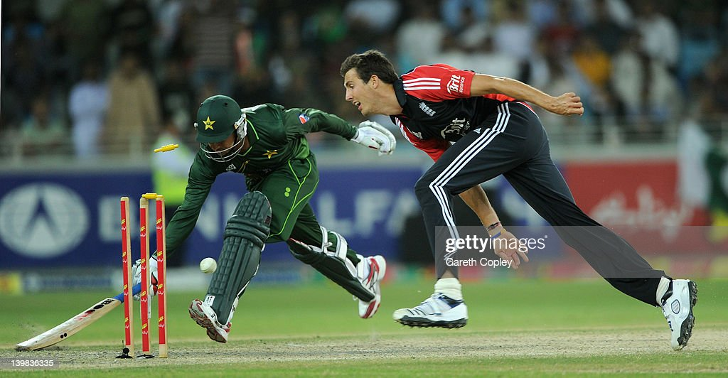 Steven Finn of England runs out <a gi-track='captionPersonalityLinkClicked' href=/galleries/search?phrase=Saeed+Ajmal&family=editorial&specificpeople=2247219 ng-click='$event.stopPropagation()'>Saeed Ajmal</a> of Pakistan during the 2nd International Twenty20 Match between Pakistan and England at Dubai International Stadium on February 25, 2012 in Dubai, United Arab Emirates.