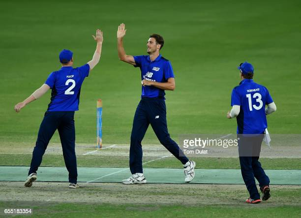 Steven Finn of The South celebrates taking the wicket of Sam Hain of The North during Game Two of the ECB North versus South Series at Dubai...