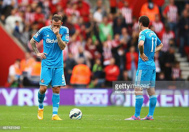 Steven Fletcher and Adam Johnson of Sunderland look dejected during the Barclays Premier League match between Southampton and Sunderland at St Mary's...