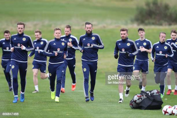 Steven Fletcher leads the players during a training session at Mar Hall on March 23 2017 in Erskine Scotland