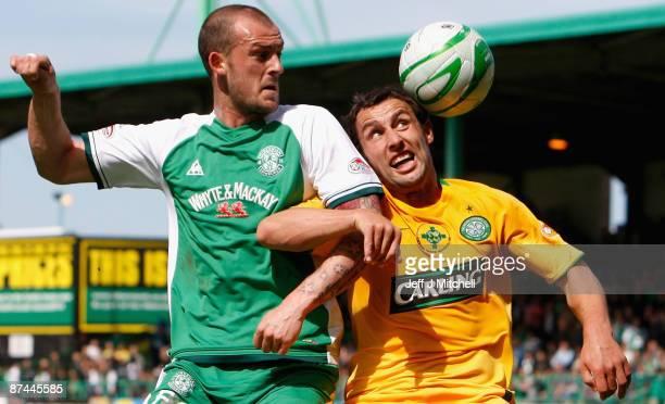 Steven Fletcher of Hibernian tackles Scott McDonald of Celtic during the Scottish Premier League match between Hibernian and Celtic at Easter Road on...