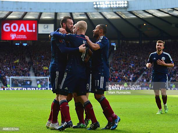 Steven Fletcher of Scotland celebrates scoring their second goal with team mates during the EURO 2016 Qualifier match between Scotland and Gibraltar...