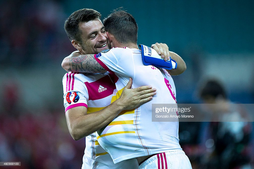 Steven Fletcher (R) of Scotland celebrates their victory with teammate Russell Martin (L) after winning the UEFA EURO 2016 Qualifying round Group G match between Gibraltar and Scotland at Estadio Algarve on October 11, 2015 in Faro, Portugal.