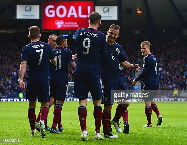 Steven Fletcher of Scotland is congratulated on scoring the second goal by Shaun Maloney of Scotland during the EURO 2016 Qualifier match between...