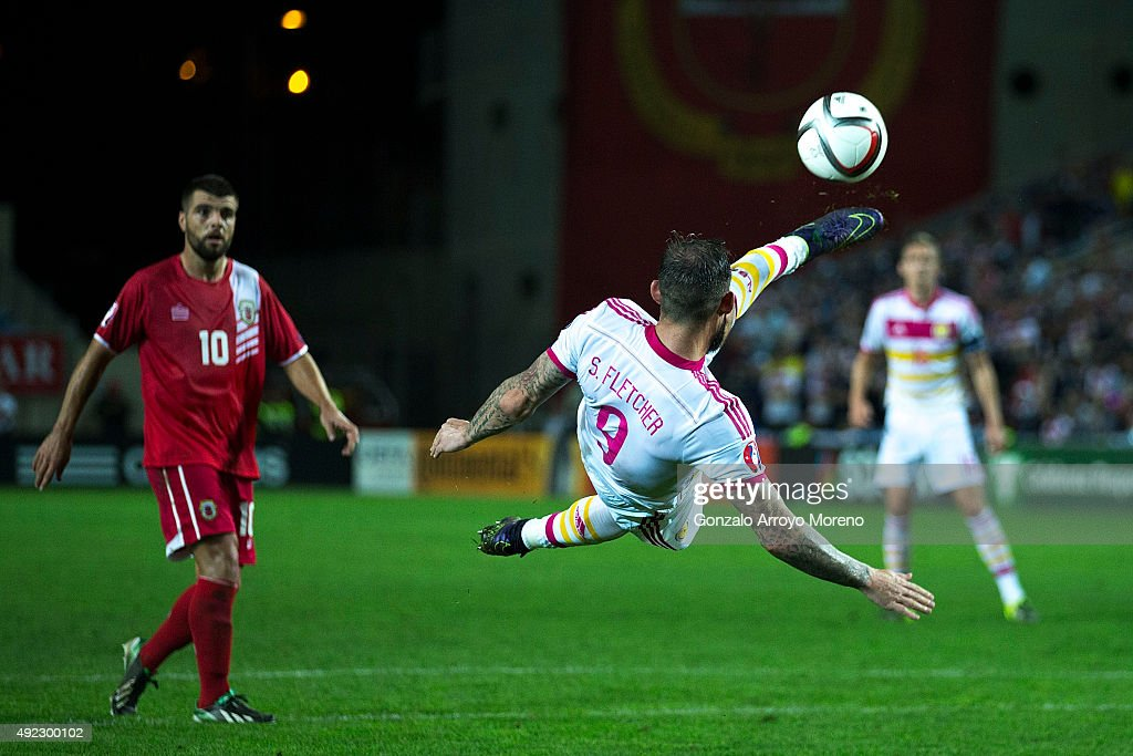 Steven Fletcher of Scotland strikes with a scissor kick during the UEFA EURO 2016 Qualifying round Group G match between Gibraltar and Scotland at Estadio Algarve on October 11, 2015 in Faro, Portugal.