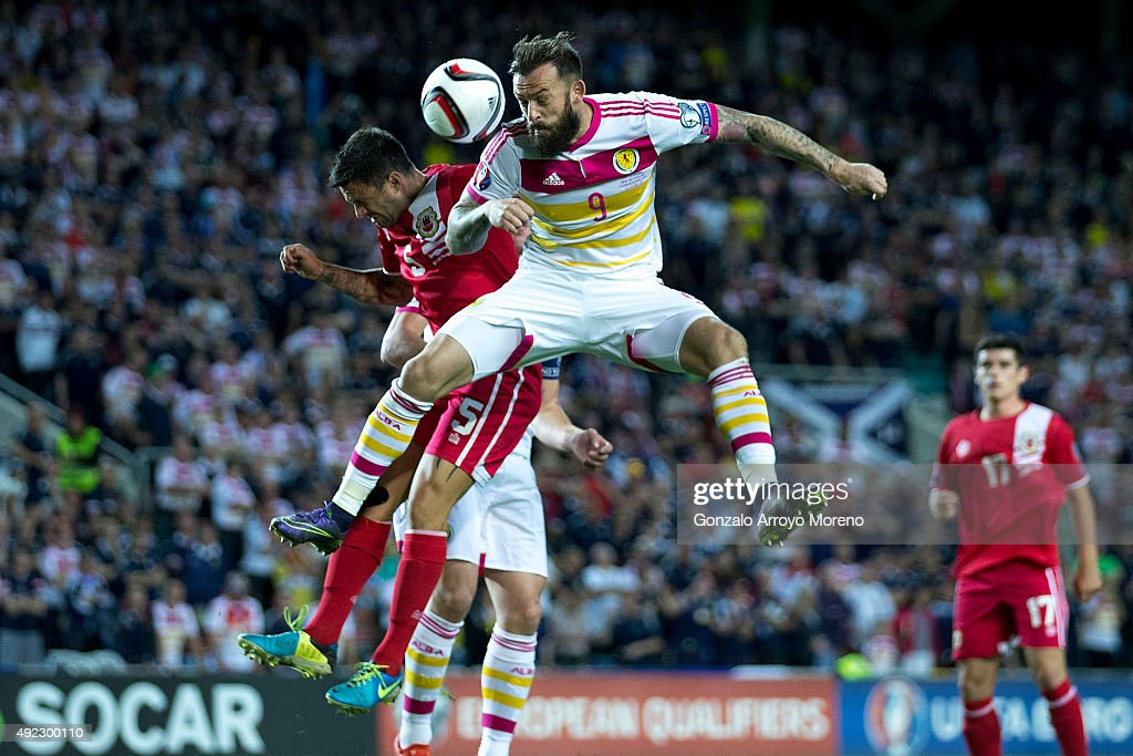 Steven Fletcher of Scotland wins the header after Ryan Casciaro of Gibraltar during the UEFA EURO 2016 Qualifying round Group G match between Gibraltar and Scotland at Estadio Algarve on October 11, 2015 in Faro, Portugal.