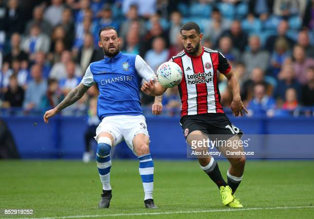 Steven Fletcher of Sheffield Wednesday and Cameron CarterVickers of Sheffield United battle for the ball during the Sky Bet Championship match...