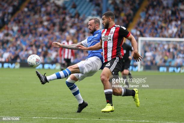 Steven Fletcher of Sheffield Wednesday and Cameron CarterVickers of Sheffield United during the Sky Bet Championship match between Sheffield...