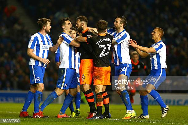 Steven Fletcher of Sheffield Wednesday argues with Brighton players leaidng to a red card during the Sky Bet Championship match between Brighton Hove...