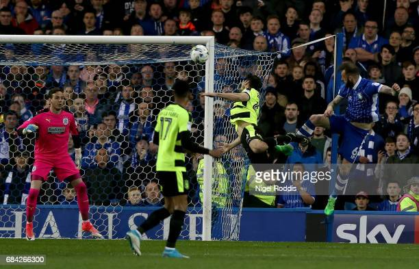 Steven Fletcher of Sheffield Wednesday scores his sides first goal past Danny Ward of Huddersfield Town during the Sky Bet Championship play off semi...