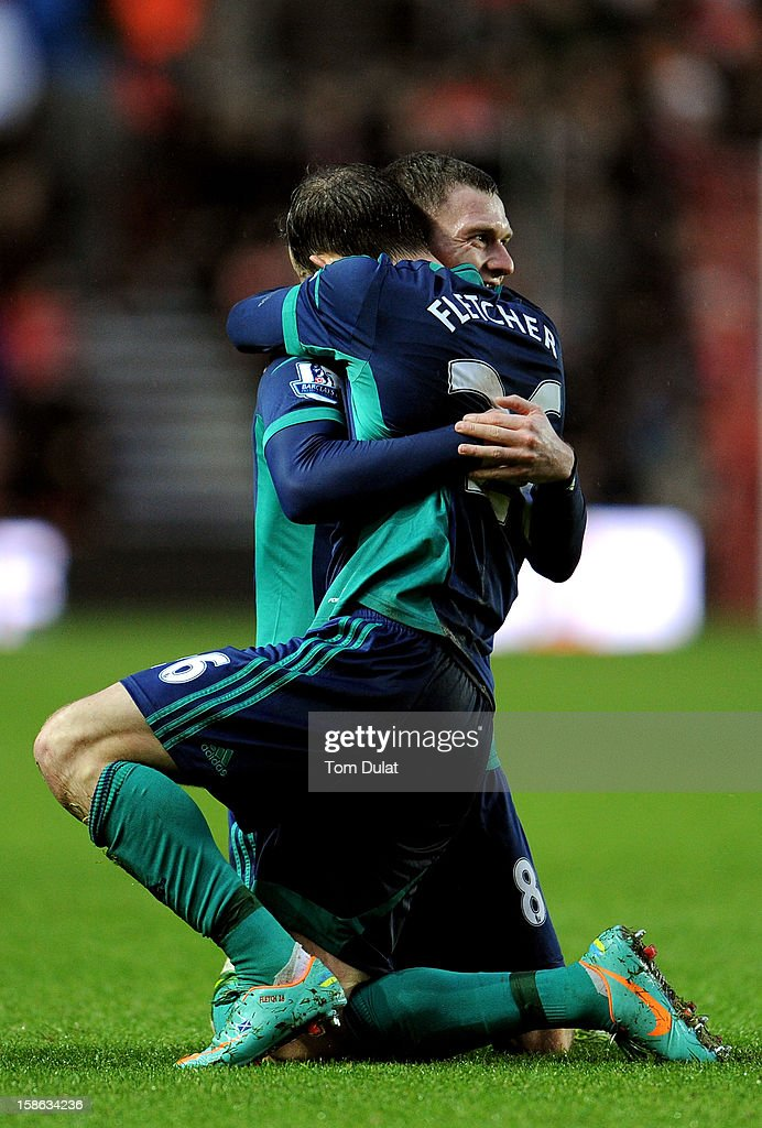 Steven Fletcher #26 of Sunderland is congratulated by teammate Craig Gardner after scoring his team's opening goal during the Barclays Premier League match between Southampton and Sunderland at St Mary's Stadium on December 22, 2012 in Southampton, England.