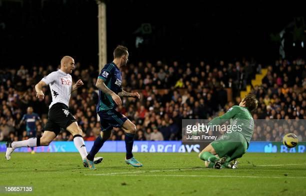 Steven Fletcher of Sunderland scores the opening goal past goalkeeper Mark Schwartzer of Fulham during the Barclays Premier League match between...