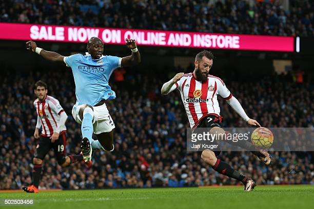 Steven Fletcher of Sunderland takes a shot on goal under pressure from Eliaquim Mangala of Manchester City during the Barclays Premier League match...