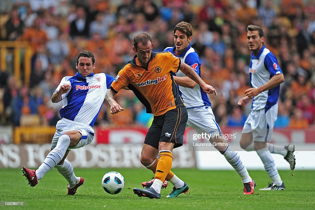 Steven Fletcher of Wolverhampton Wanderers scores under pressure from Christophe Berra of Atletico Bilbao during the Pre Season Friendly match between Wolverhampton Wanderers and Atletico Blbao at Molineux on August 7, 2010 in Wolverhampton, England.