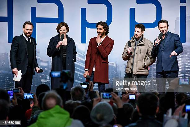 Steven Gaetjen Sigourney Weaver Dev Patel Neill Blomkamp and Hugh Jackman attend a fan event for the film 'CHAPPIE' at Mall of Berlin on February 27...