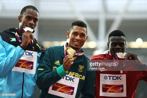 Steven Gardiner of the Bahamas silver Wayde van Niekerk of South Africa gold and Abdalelah Haroun of Qatar bronze pose with their medals for the...