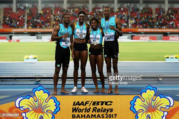 Steven Gardiner Shaunae MillerUibo Anthonique Strachan and Michael Mathieu of the Bahamas celebrate on the podium after placing first in the Mixed...