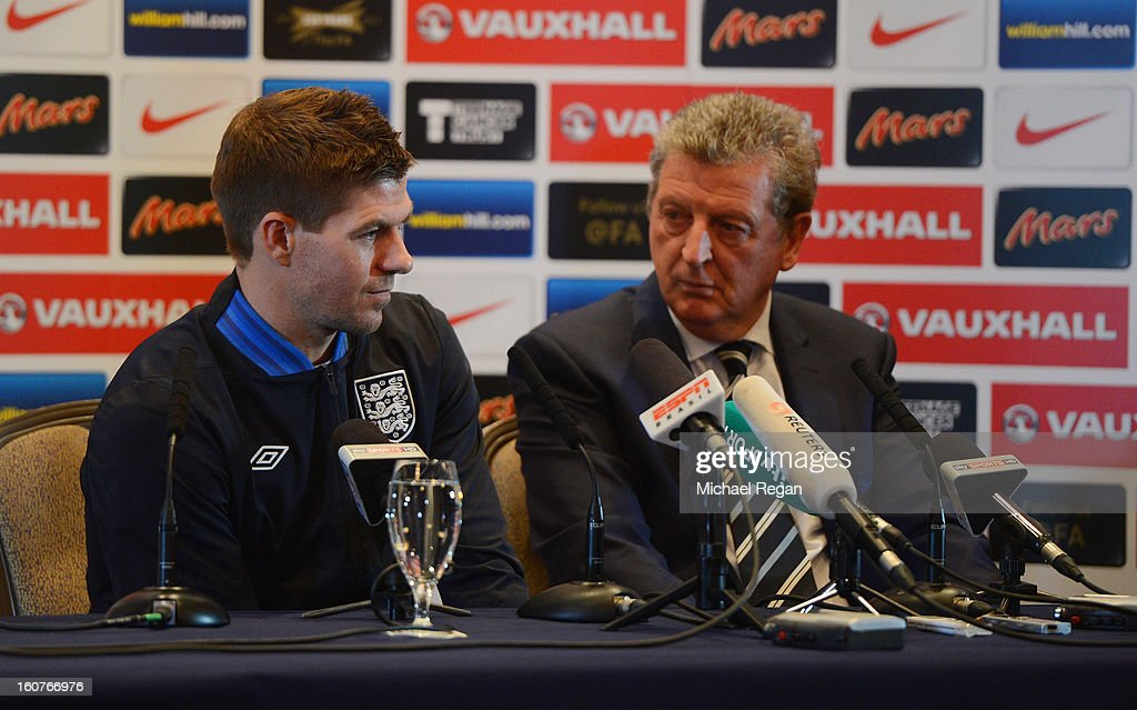 <a gi-track='captionPersonalityLinkClicked' href=/galleries/search?phrase=Steven+Gerrard&family=editorial&specificpeople=202052 ng-click='$event.stopPropagation()'>Steven Gerrard</a> (L) and England manager <a gi-track='captionPersonalityLinkClicked' href=/galleries/search?phrase=Roy+Hodgson&family=editorial&specificpeople=881703 ng-click='$event.stopPropagation()'>Roy Hodgson</a> speak to the media during the England press conference at the Churchill Hotel on February 5, 2013 in London, England.