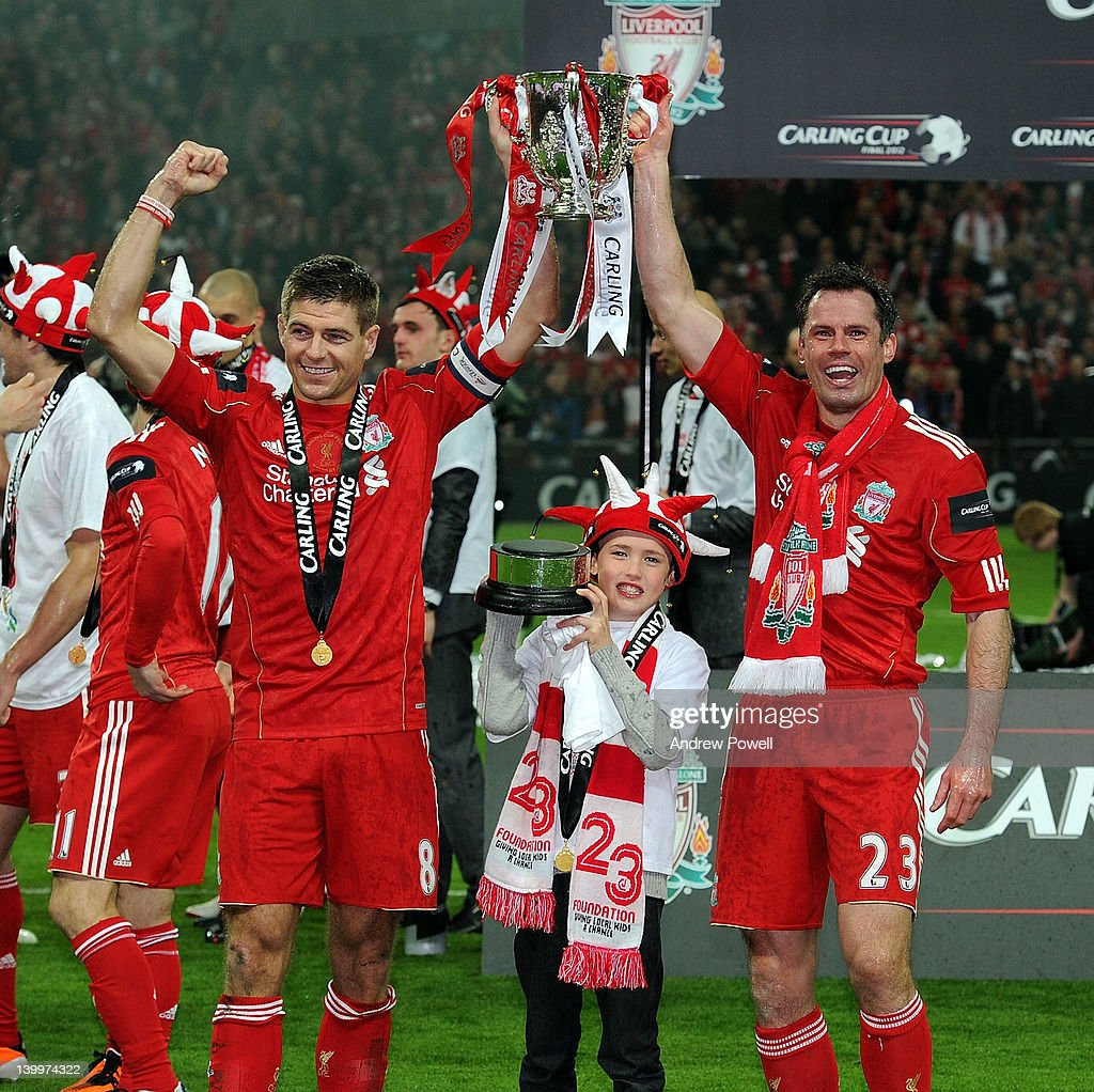 <a gi-track='captionPersonalityLinkClicked' href=/galleries/search?phrase=Steven+Gerrard&family=editorial&specificpeople=202052 ng-click='$event.stopPropagation()'>Steven Gerrard</a> and <a gi-track='captionPersonalityLinkClicked' href=/galleries/search?phrase=Jamie+Carragher&family=editorial&specificpeople=206485 ng-click='$event.stopPropagation()'>Jamie Carragher</a> of Liverpool hold the trophy aloft and celebrate at the end of the Carling Cup Final match between Liverpool and Cardiff City at Wembley Stadium on February 26, 2012 in London, England.