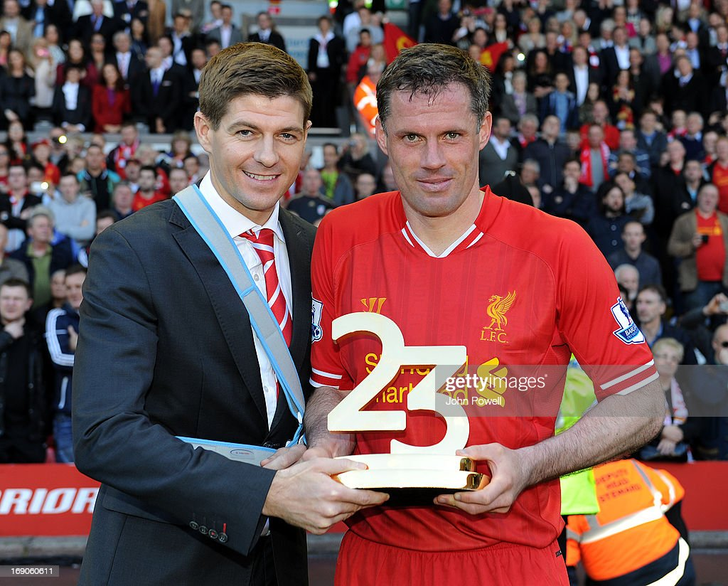 <a gi-track='captionPersonalityLinkClicked' href=/galleries/search?phrase=Steven+Gerrard&family=editorial&specificpeople=202052 ng-click='$event.stopPropagation()'>Steven Gerrard</a> and <a gi-track='captionPersonalityLinkClicked' href=/galleries/search?phrase=Jamie+Carragher&family=editorial&specificpeople=206485 ng-click='$event.stopPropagation()'>Jamie Carragher</a> of Liverpool hold the trophy awarded to <a gi-track='captionPersonalityLinkClicked' href=/galleries/search?phrase=Jamie+Carragher&family=editorial&specificpeople=206485 ng-click='$event.stopPropagation()'>Jamie Carragher</a> after Carragher's last game, during the Barclays Premier League match between Liverpool and Queens Park Rangers at Anfield on May 19, 2013 in Liverpool England.