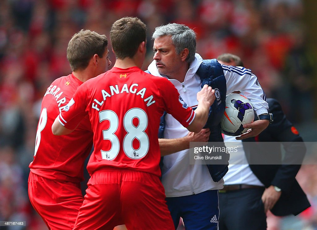 Steven Gerrard and Jon Flanagan of Liverpool have words with Jose Mourinho manager of Chelsea as he holds onto the ball during the Barclays Premier League match between Liverpool and Chelsea at Anfield on April 27, 2014 in Liverpool, England.