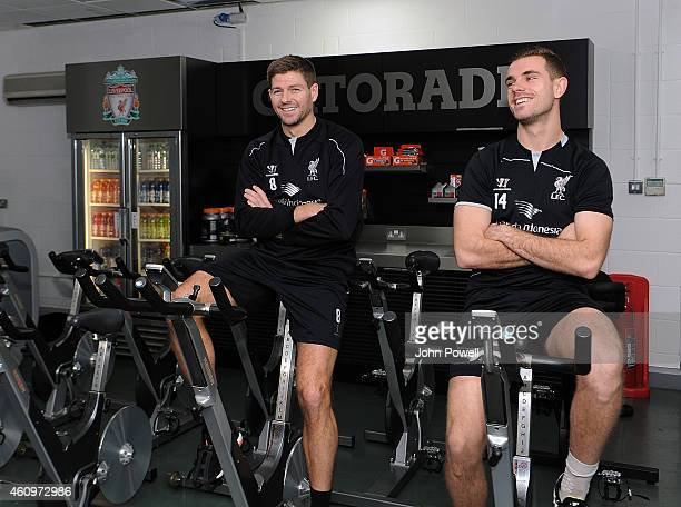 Steven Gerrard and Jordan Henderson of Liverpool during a training session at Melwood Training Ground on January 2 2015 in Liverpool England