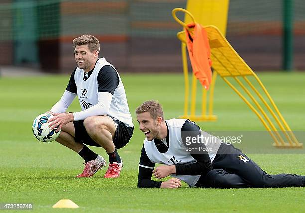 Steven Gerrard and Jordan Henderson of Liverpool in action during a training session at Melwood Training Ground on May 14 2015 in Liverpool England