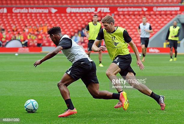 Steven Gerrard and Jordon Ibe of Liverpool in action during a training session at Anfield on August 8 2014 in Liverpool England