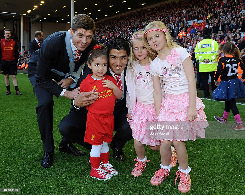<a gi-track='captionPersonalityLinkClicked' href=/galleries/search?phrase=Steven+Gerrard&family=editorial&specificpeople=202052 ng-click='$event.stopPropagation()'>Steven Gerrard</a> and Luis Suarez of Liverpool pose at the end of the Barclays Premier League match between Liverpool and Queens Park Rangers at Anfield on May 19, 2013 in Liverpool England.