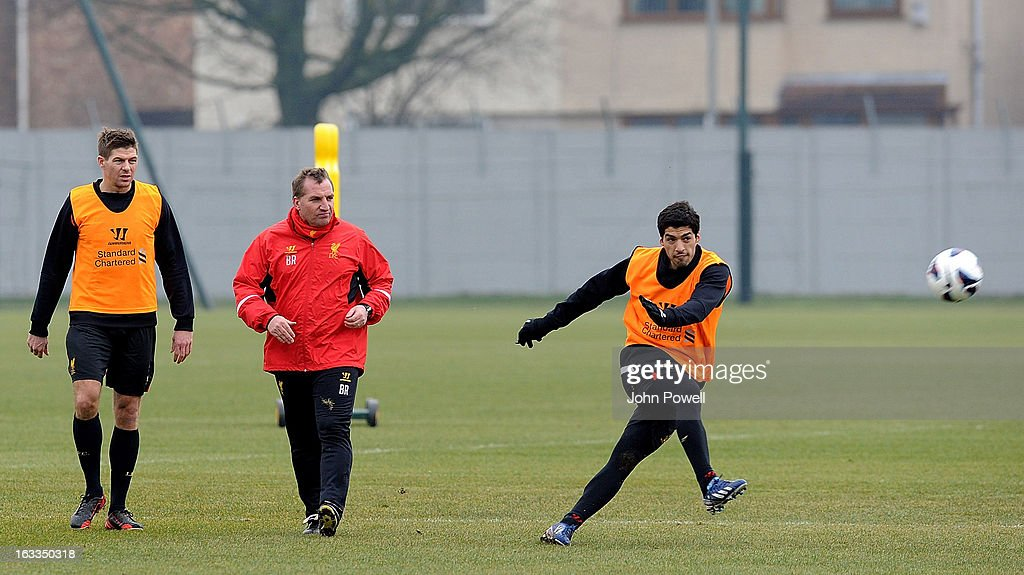 Steven Gerrard and manager Brendan Rodgers of Liverpool watch Luis Suarez in action during a training session at Melwood Training Ground on March 8, 2013 in Liverpool, England.