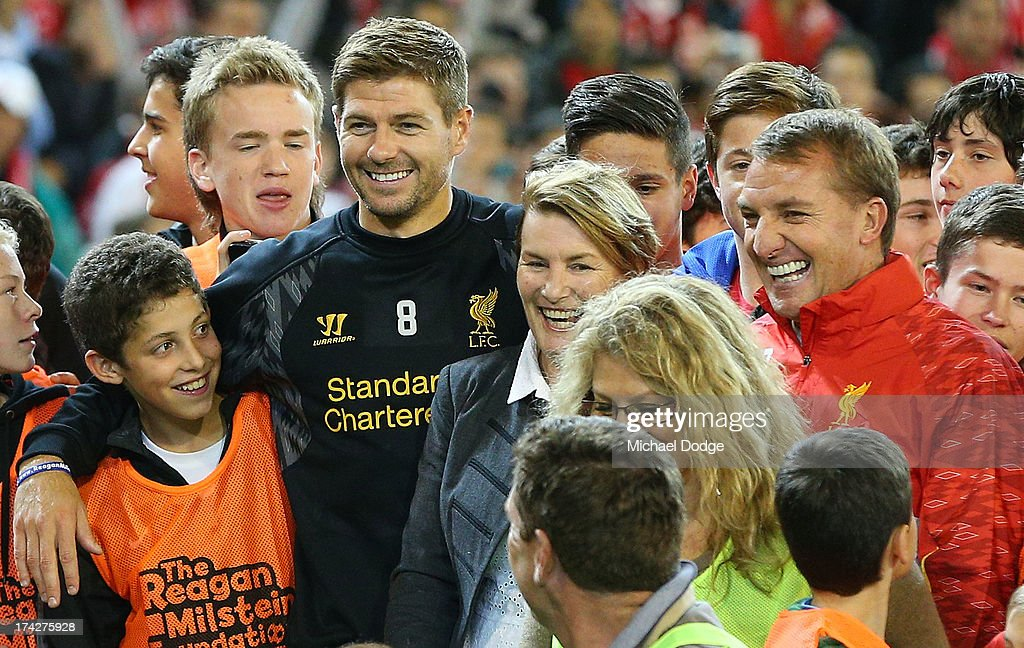<a gi-track='captionPersonalityLinkClicked' href=/galleries/search?phrase=Steven+Gerrard&family=editorial&specificpeople=202052 ng-click='$event.stopPropagation()'>Steven Gerrard</a> and Manager <a gi-track='captionPersonalityLinkClicked' href=/galleries/search?phrase=Brendan+Rodgers+-+Soccer+Manager&family=editorial&specificpeople=5446684 ng-click='$event.stopPropagation()'>Brendan Rodgers</a> (R) pose for a photo with fans during a Liverpool FC training session at Melbourne Cricket Ground on July 23, 2013 in Melbourne, Australia.