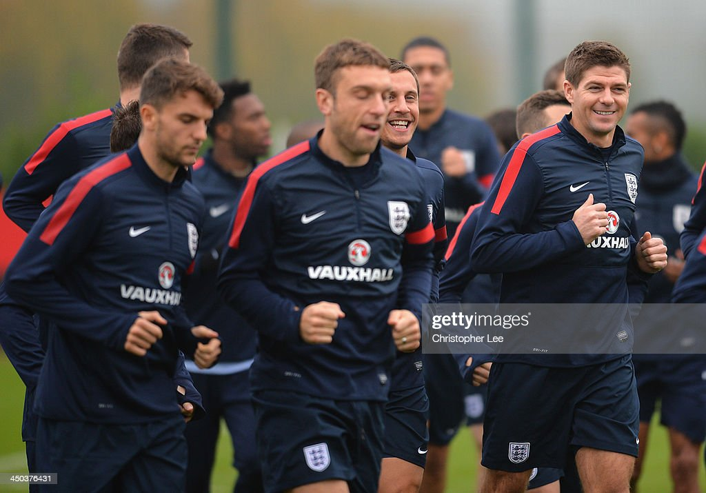 Steven Gerrard and Phil Jagielka smile during England Training at London Colney on November 18, 2013 in St Albans, England.