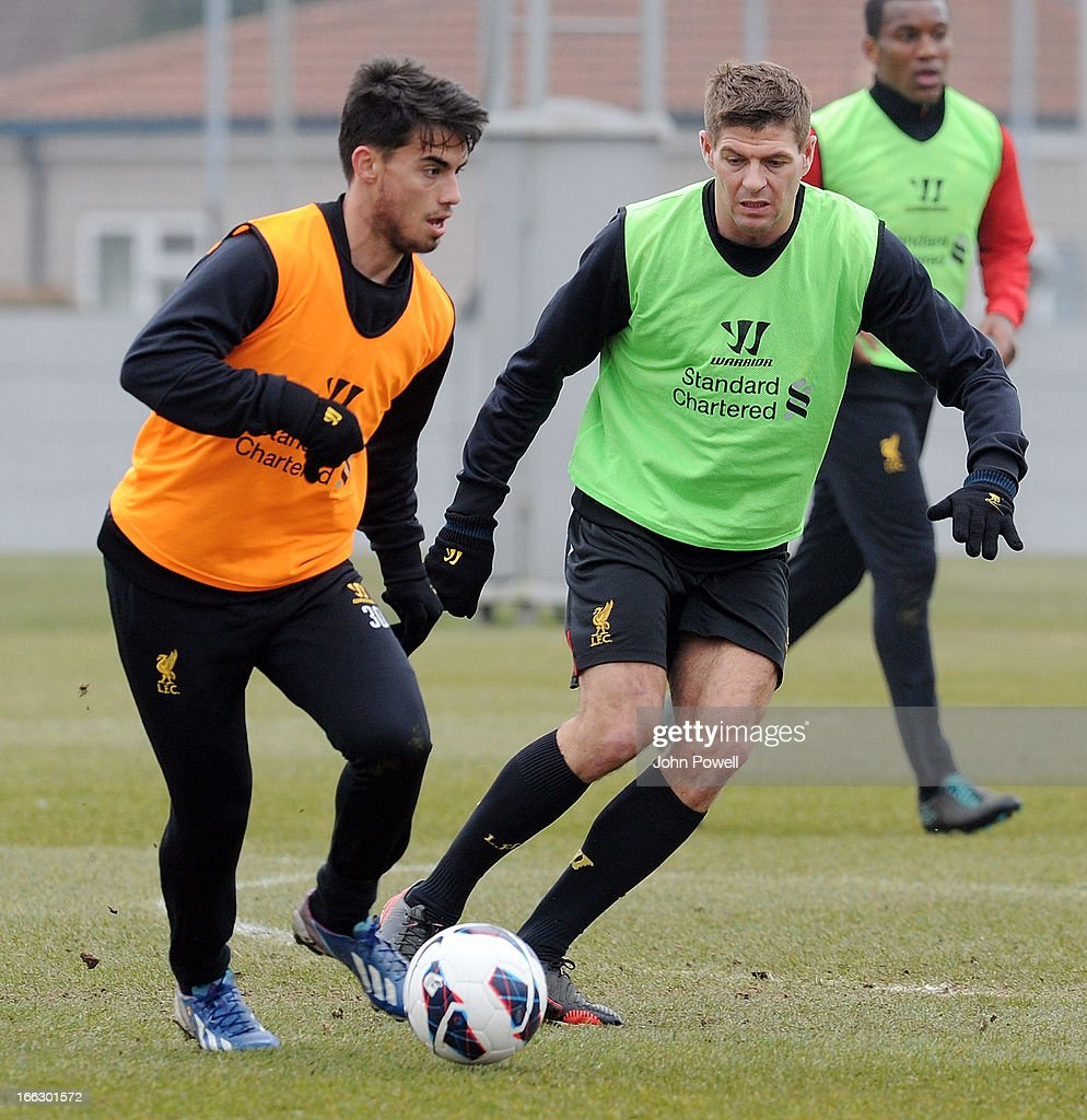 Steven Gerrard and Suso of Liverpool in action during a training session at Melwood Training Ground on April 11, 2013 in Liverpool, England.