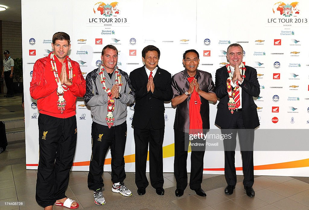 Steven Gerrard, Brendan Rodgers manager of Liverpool and Ian Ayre managing director of Liverpool pose for a photograph as they arrive in Bangkok for a stop on the club's Pre-Season tour on July 25, 2013 in Bangkok, Thailand.