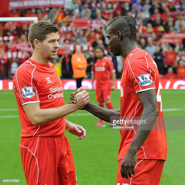Steven Gerrard captain of Liverpool shakes hands with Mario Balotelli of Liverpool before the kick off of the Barclays Premier League match between...