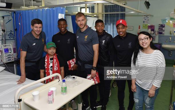 Steven Gerrard ex player for Liverpool with Rhian Brewster Ragnar Klavan Nathaniel Clyne and Georginio Wijnaldum of Liverpool during a visit to...