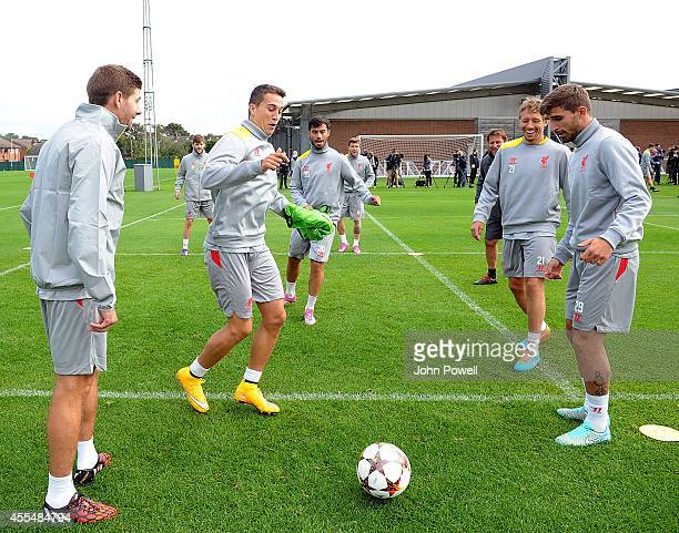 Steven Gerrard Fabio Borini Lucas Leiva and Javier Manquillo of Liverpool during a training session at Melwood Training ground on September 15 2014...
